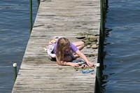 Julia assessing her treasures on the dock