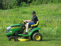 Nathan mowing