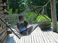 Julia reading in the hammock