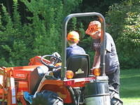 Dad teaching Nathan how to drive the Kubota