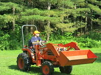 Nathan driving the Kubota in the circle
